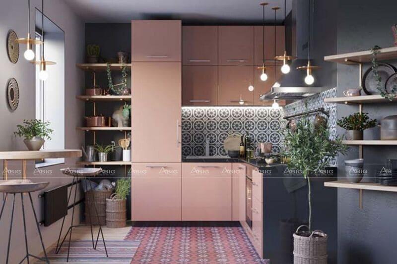 không gian khu bếp được thiết kế với tone màu hồng pastel với đá ốp bếp hoa văn độc đáo