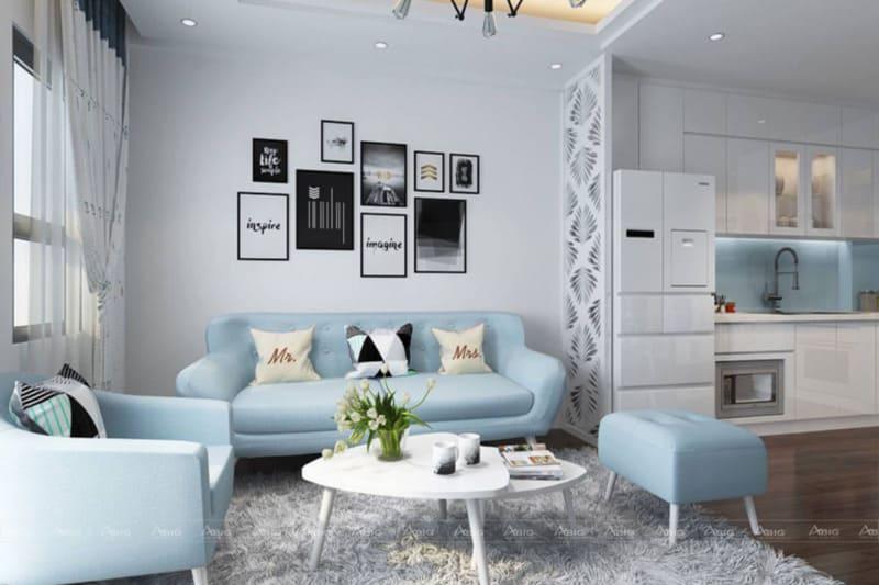 Màu trắng chủ đạo kết hợp với sofa màu xanh tạo nét tươi mới