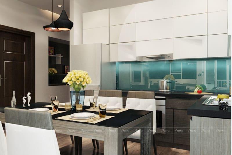 Ranh giới được phân chia nhờ vào vị trí thảm trải sàn. Phòng ăn thiết kế nhỏ gọn.