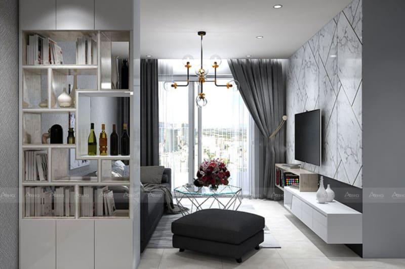 Không gian phòng khách và phòng bếp được ngăn bằng kệ đựng sách