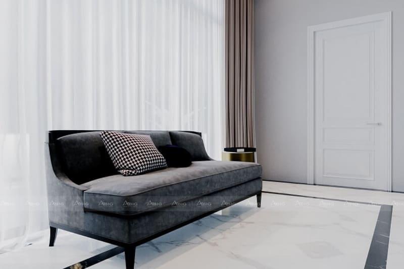 sofa màu ghi đậm nổi bật trên nền gạch trắng sáng bóng